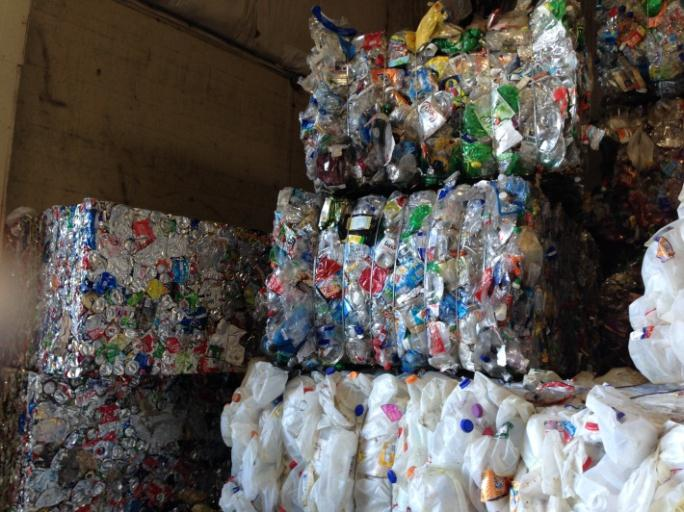 Stacks of plastic containers that are being recycled.