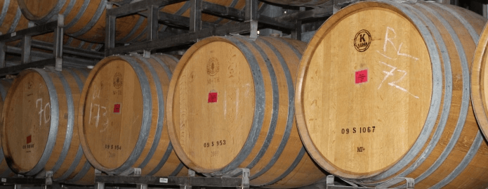 A row of wooden wine barrels.